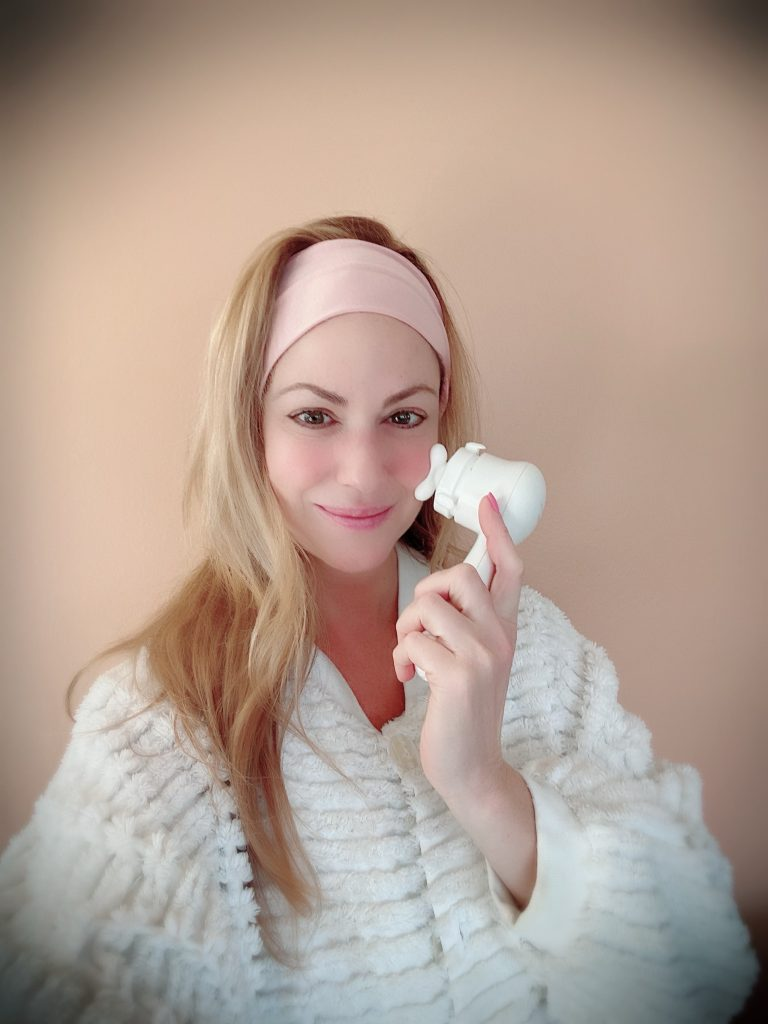 Joy showing how to use the Clarisonic Mia Smart Massager head for more uplifted skin results.